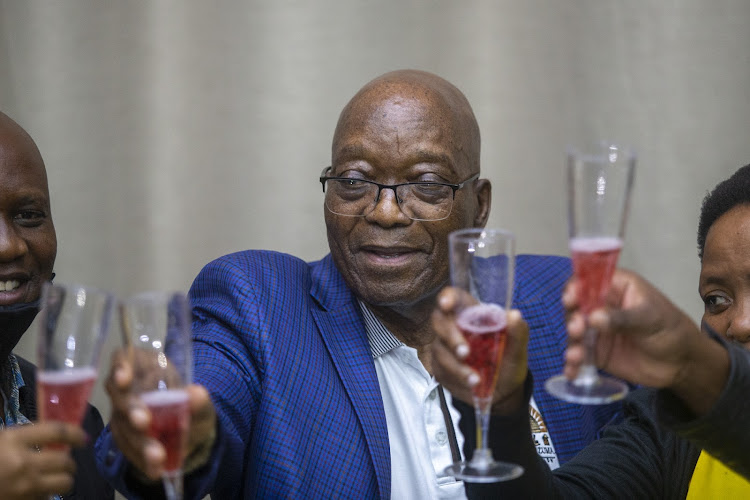 Zuma popped a bottle of non-alcoholic champagne before being given a toast by his Sanco comrades.