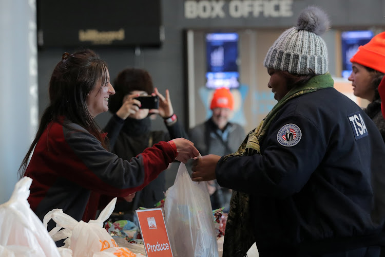 A Transportation Security Administration (TSA) employee receives a donation at a food distribution center for federal workers impacted by the government shutdown, at the Barclays Center in the Brooklyn borough of New York, US, January 22, 2019.