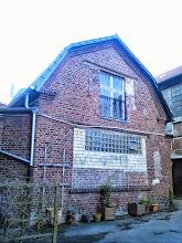 Photo: Ein Nebengebäude im Hinterhof von Haus Nr. 3 mit interessanter, mehrfach veränderter Fassadengestaltung.