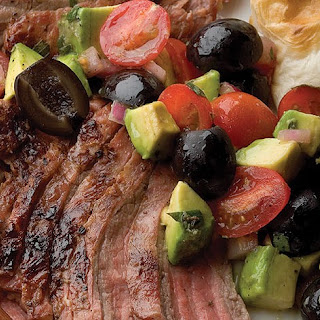 Grilled Flank Steak with Avocado and Olive Salsa.