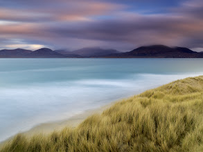 Photo: Isle of Harris, Scotland  This is Luskentyre Beach, certainly one of the most beautiful beaches I have ever seen. I was constantly amazed by the color palette that was on display on the Isle of Harris' beaches. The deep turquoise blue hue of the sea combined with juicy yellows of the sand can't be properly described by words. On top, I got lucky (only) one morning with the sunrise performance that perfectly complemented the range of colors to watch.  Enjoy and share!