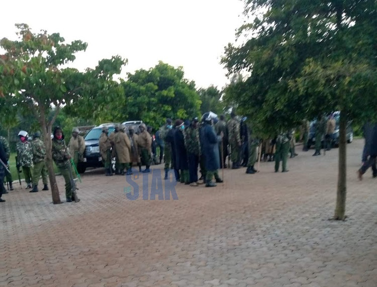 Some of the police officers deployed at Sudi's home before they left early Saturday.
