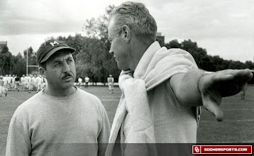 Photo: Wilkinson, right, discussing football with his Mexican counterpart, Roberto Mendez, during the 1957 trip to Mexico City.