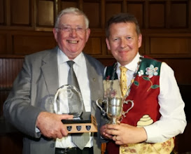 Photo: Tom Canning , receiving his trophies for sections and maximum points from INIB President Bill Turnbull