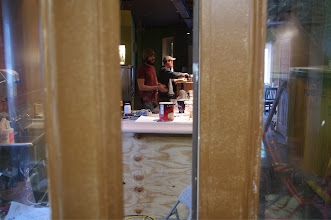 Photo: Collin Farrell and Jeff McCracken at work on the first floor bar.