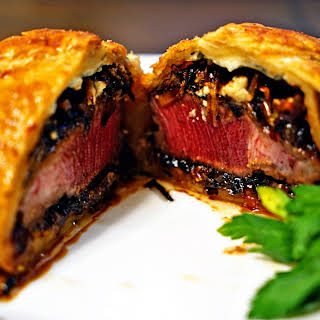 Individual Beef Wellingtons with Caramelized Onions and Bleu Cheese Rosemary Compound Butter.