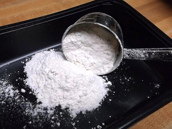 To prepare dredge mixture, in a shallow dish, mix together 1 cup flour, 1...