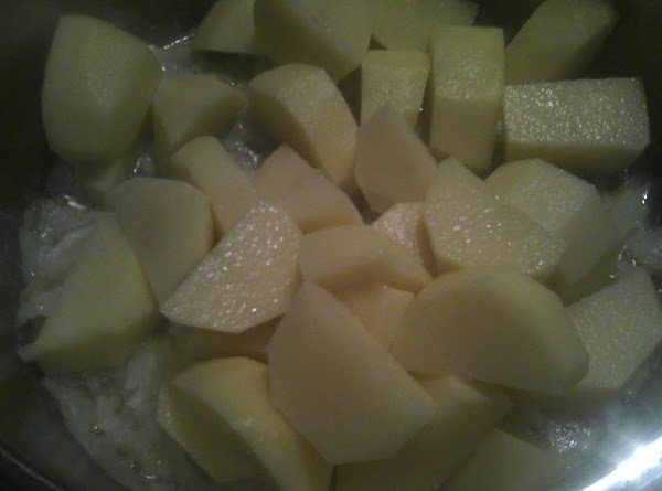 While the onions are cooking, peel, wash and dry off potatoes, cut them in...