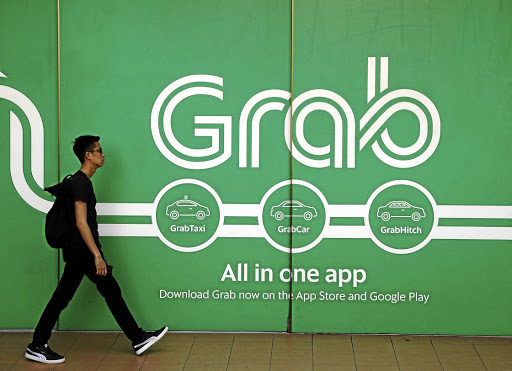 A man walks past a Grab office in Singapore. Picture: REUTERS