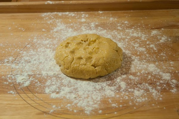 After 10 minutes, remove the dough from the bowl, and place on a lightly...
