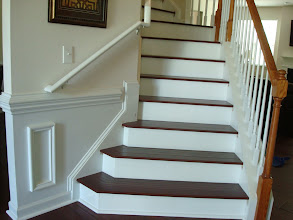 Photo: This is a handscraped product that we custom wrapped over each tread to keep the same look and feel on the stairs. (We were waiting for the customer to bring us the touch up paint, as you can see,...).