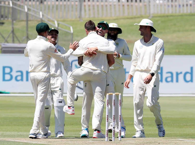 Dale Steyn is given a congratulatory hug from his captain Faf du Plessis after taking his record-breaking 422nd wicket to become SA's leading wicket taker on the opening day of the first Test between the Proteas and Pakistan at SuperSport Park in Centurion on Wednesday December 26 2018.