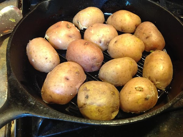 Add halves potatoes to a large bowl and add 1/4 cup olive oil and...