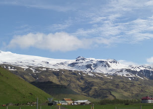 Photo: This is where the Eyjafjallajokull eruption of 2010 occurred, snarling air traffic throughout Europe.  We saw a film of the effect it had on this farm.