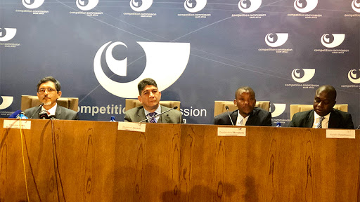 From left: Minister of trade and industry Ibrahim Patel, Vodacom Group CEO Shameel Joosub, commissioner of the Competition Commission Tembinkosi Bonakele, and deputy commissioner of the Competition Commission Hardin Ratshisusu.