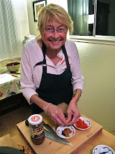 Photo: Kathy pitting pickled plums