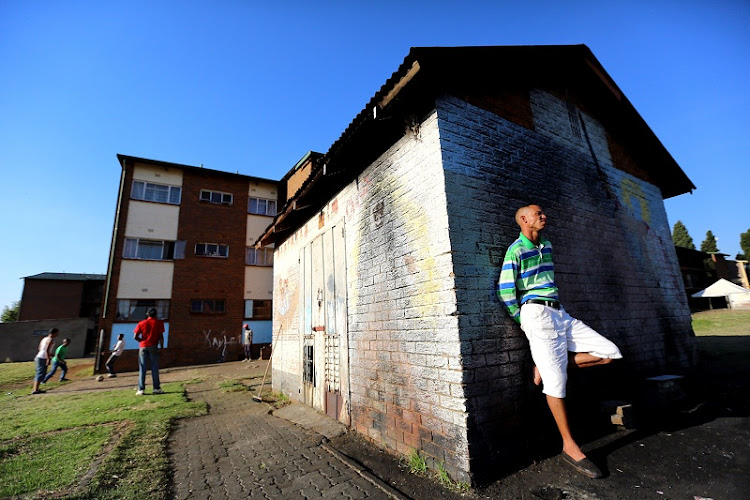 A resident of Eldorado Park, south of Johannesburg, stands in front a power station. Picture: THE TIMES