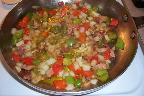 After all the peppers, etc are softened, put in sauce, then in the same...