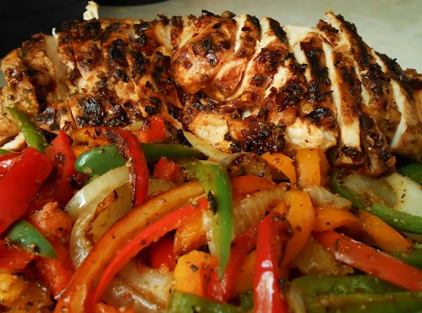 Slice chicken into thin slices, place on corn tortilla with pepper and onion, top...