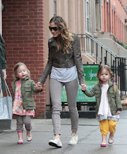 Photo: Sarah Jessica Parker's daughters Tabitha and Marion keep dry from the rain with their Hello Kitty rainboots!  Credit: 2013 FameFlynet, Inc