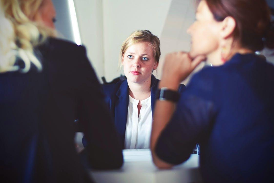 3 Women in Suit Sitting