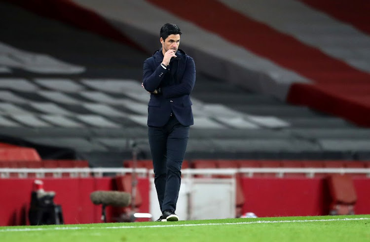 Distressed Arsenal manager Mikel Arteta looks on during the Premier League match between his side and Liverpool at Emirates Stadium in London, England.