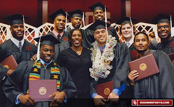 Photo: Teresa Turner with 2006 OU football graduates.