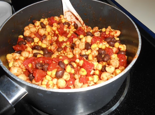 In a large saucepan, combine diced tomatoes, onion, beans, corn, and chili powder; mix...