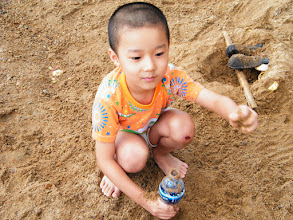 Photo: baby son in game with sands.
