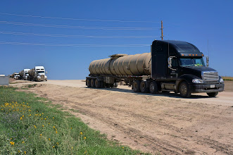 Photo: Oil tank trucks filled with Bakken crude oil awaiting their turns to unload.