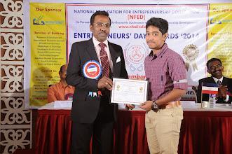 Photo: Prof. Dr. R. Ganesan, Chairman, NFED Issuing Certificate of Appreciation To Programme Anchor, Mr. S. Santhosh Kumar, I Year Higher Secondary, Padma Seshadri Bala Bhavan Senior Secondary School, Chennai