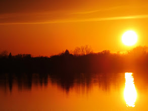 Photo: Gorgeous fiery sunset on a lake at Eastwood park in Dayton, Ohio.