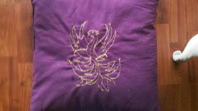 Photo: Chain stitch phoenix for heraldic bed linens in camp