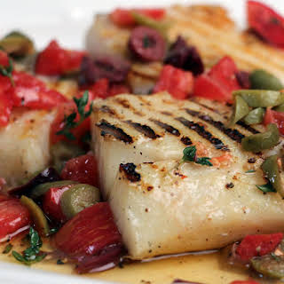 Grilled Bacalao (Salt Cod) Steaks with Olive Sauce.