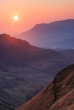 Photo: Drakensberg National Park  This was one of the more challenging sunrises I've ever witnessed, but boy was it worth it. To get to this point we set out at 3:30am and hiked up towards Cathedral Peak in the pitch dark. By 4am we were wading thigh deep through an icy cold river, torches in mouths... if we weren't fully awake before the river crossing we sure were afterwards!  We made it up to the ridgeline where this photo was taken from in time for a spectacular 360° view at sunrise. After a good break for breakfast and photos, we carried on and tried to make it to the 3004m high summit. Unfortunately we had to turn back a couple of hundred metres short because the snow was too deep and the rocks too slippery. That didn't detract from an incredible (and incredibly tough) day however. By the time we arrived back 'home' at about 4pm we'd hiked up and down more than 1600m vertically, covering a total distance of 21km. Everyone was exhausted and everyone was smiling :-)  For those who haven't heard of Drakensberg, it is the highest mountain range in Southern Africa and is listed as a UNESCO World Heritage site. There are well over 2,000 known plant species there and about 300 species of bird. There are also around 40,000 ancient rock paintings, making it the largest such collection of bushmen art in the world. If all that isn't enough of a reason to visit then I should point out that the area is also stunningly beautiful!  #MountainMonday by +Michael Russell(+Mountain Monday) #NationalParksMonday by +Juan Pons(+NationalParksMonday) #NatureMonday by +Rolf Hickerand +Kate Church