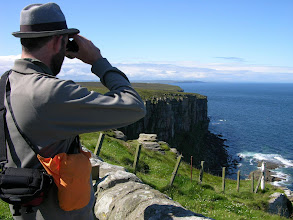 Photo: Mick at the wild cliffs at the top end of Scotland