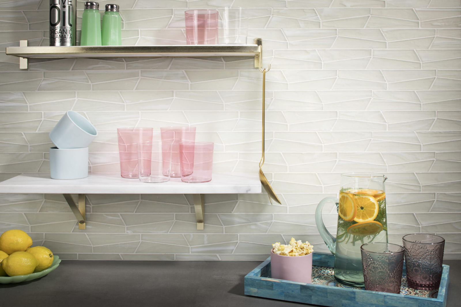 Light mosaic tile kitchen backsplash in irregular shapes