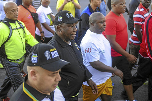 President Cyril Ramaphosa is joined by citizens during a 5km walk from the Gugulethu Sports Centre to Athlone. The writer says with VAT and petrol increases, we might as well stop hopping into our cars and start walking everywhere.