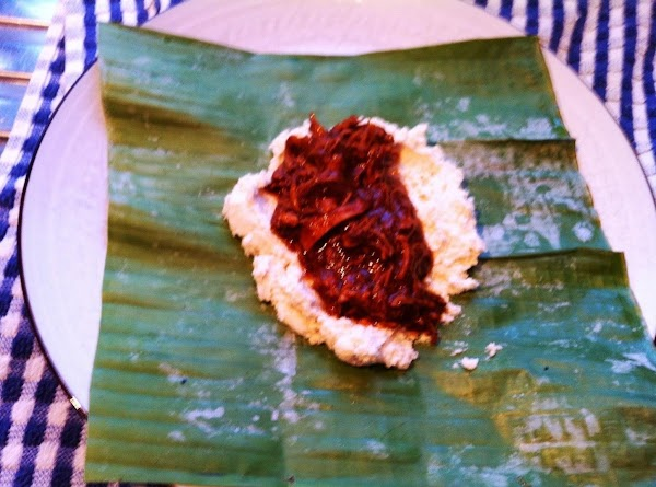 To assemble the tamales, spread 1/4 cup masa into a 3 by 5-inch rectangle...