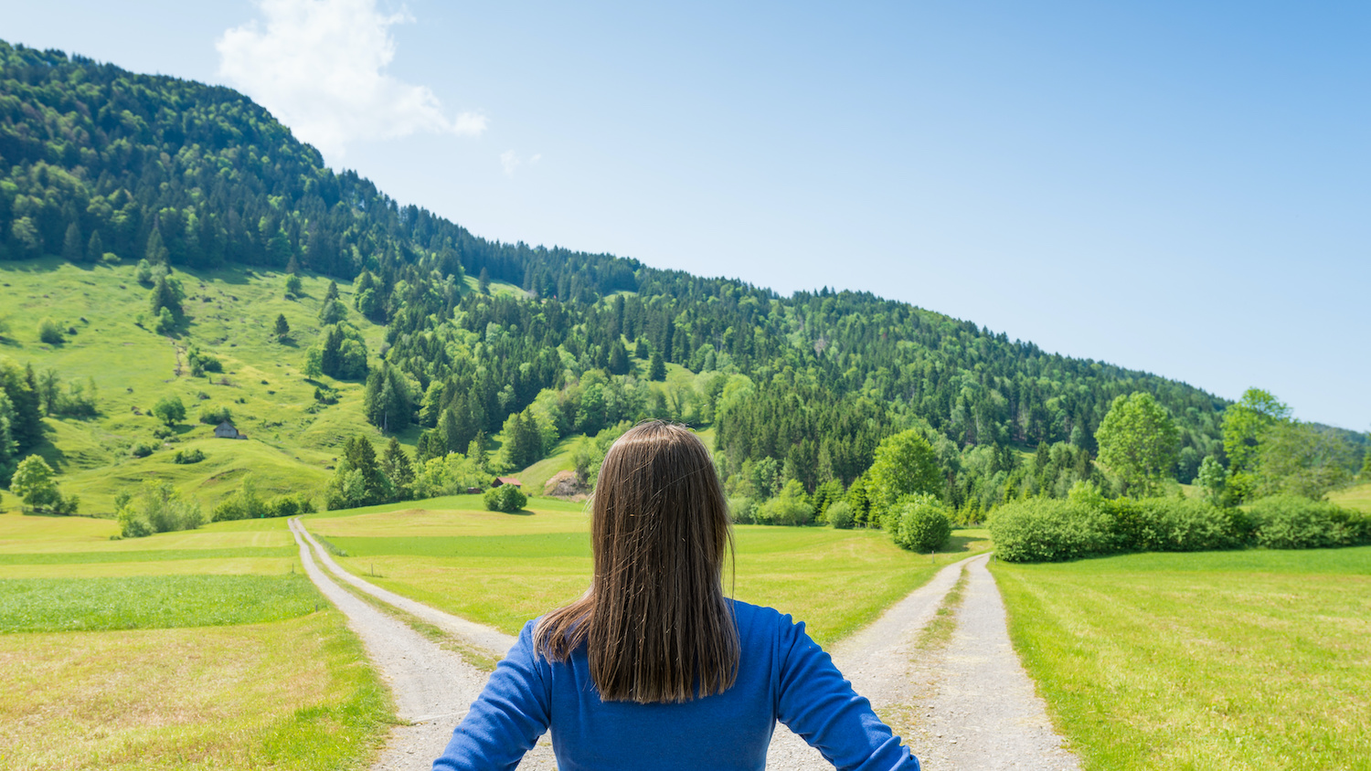 woman looking at two different paths