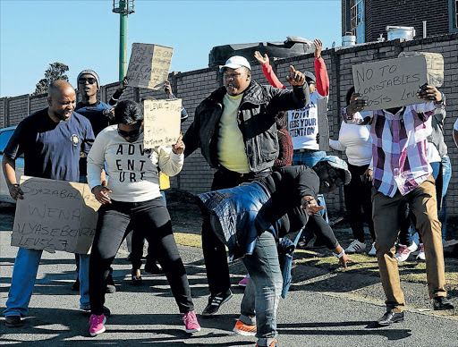 SAPS 10111 call centre operators affiliated to the South African Police Union picketed outside the call centre in Greenfields as part of a nationwide strike  Picture: RANDELL ROSKRUGE