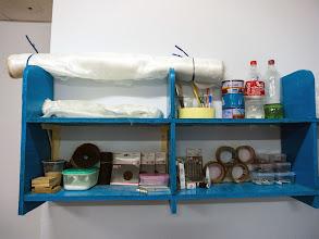 Photo: roll of 6 oz fiberglass fabric (top of the shelf)