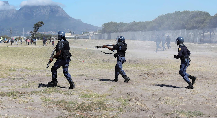 Police firing rubber bullets pursue protesting students at the Western Cape College of Nursing in Athlone, Cape Town, on February 12 2019.