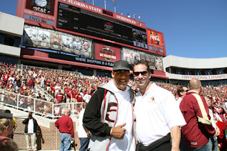 Photo: 1990 - 1992 Teams Reunion on the field before the NC State game.