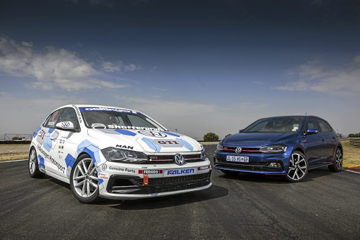 The racing-version of the Polo GTI next to its road-version.