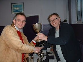 Photo: Nationwide player Sven Zeidler receives the 2009-10 Wiltshire Rapidplay Tournament Trophy from Johnathon Bourne.