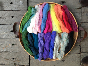 Photo: unspun dyed wool for weft insertion.