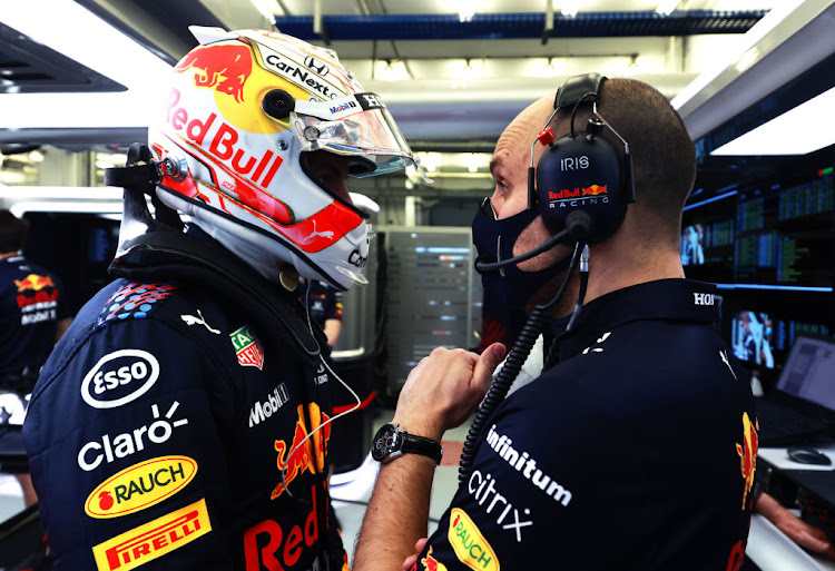 Max Verstappen of Netherlands and Red Bull Racing speaks to race engineer Gianpiero Lambiase during day three of F1 Testing at Bahrain International Circuit on March 14 2021.