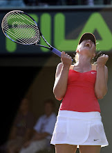 Photo: Maria Sharapova of Russia celebrates after defeating Shahar Peer of Israel, 4-6, 6-3, 6-3, at the Sony Ericsson Open tennis tournament, Thursday, March 22, 2012, in Key Biscayne, Fla. (AP Photo/Lynne Sladky)
