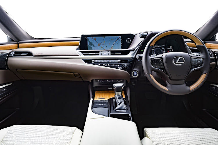 It's all luxury inside but the dashboard is very busy with buttons. Picture: SUPPLIED